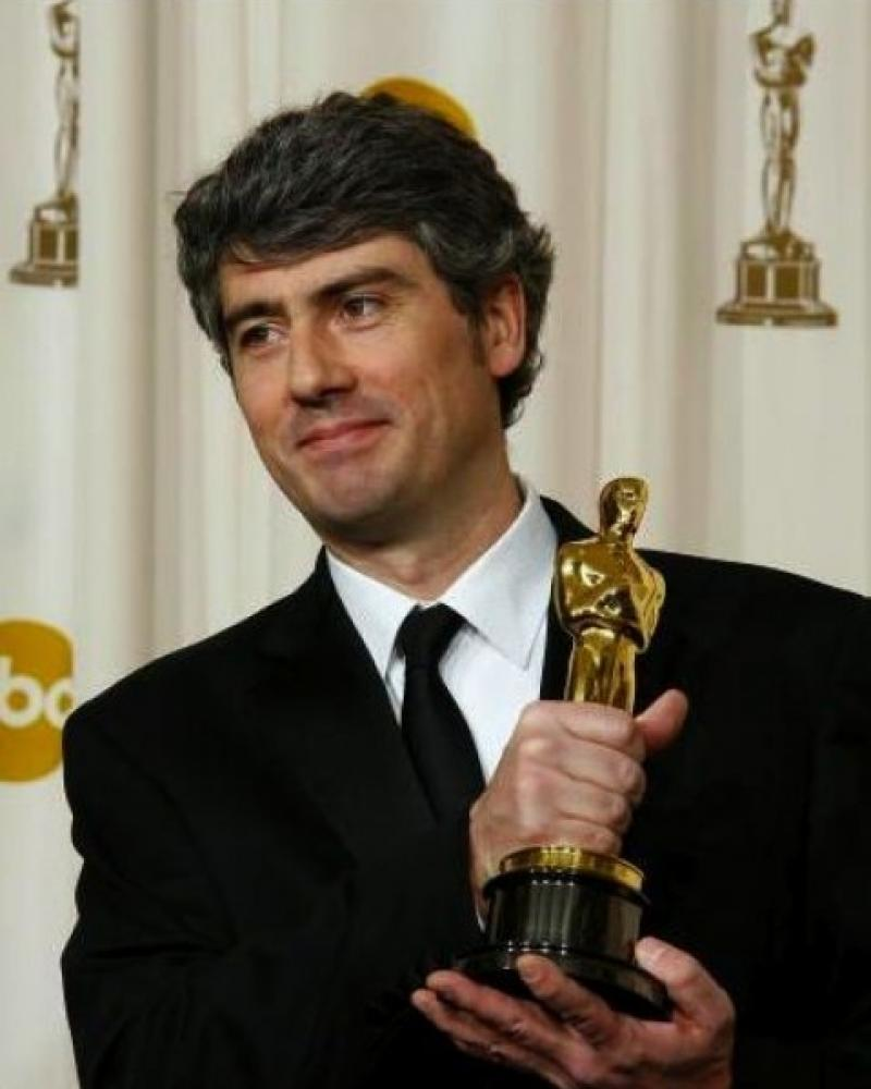 Composer Dario Marianelli wields his Oscar for his score to the film 'Atonement'