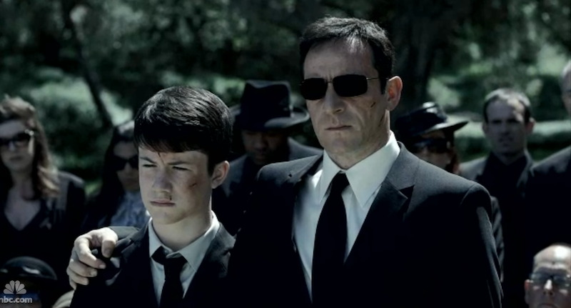 Britten (Jason Isaacs) with his son (Dylan Minnette) in Awake