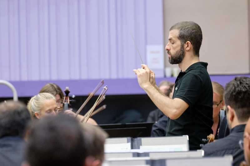 Omer Meir Wellber rehearsing with BBC Philharmonic c Mark McNulty