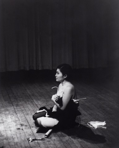Yoko Ono, Cut Piece, Carnegie Hall, NY, March 21, 1965; Photo: Minoru Niizuma; Courtesy of Yoko Ono