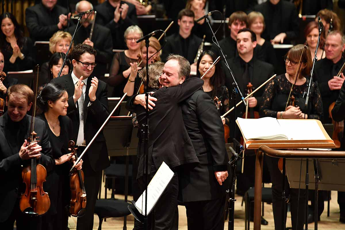 Sakari Oramo and Esa-Pekka Salonen embrace