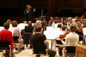 Deneve rehearsing the Royal Scottish National Orchestra