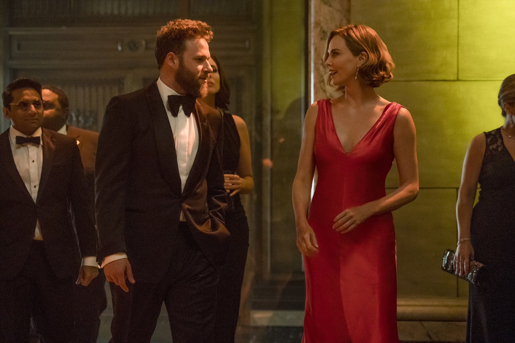 Ravi Patel, Seth Rogen and Charliza Theron in Long Shot