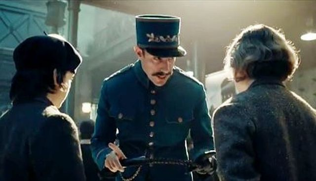 Sacha Baron Cohen bears down on Hugo's two young leads