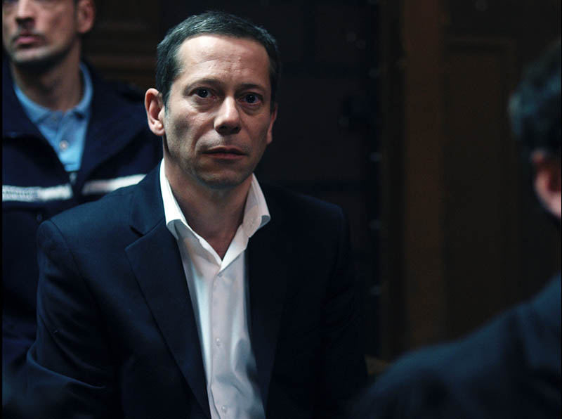 Amalric as Julien in court
