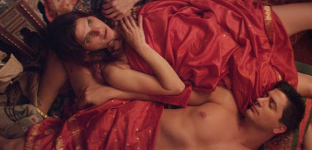 Ken Marino and Lake Bell share a bed