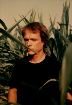 Arthur Russell in an Iowan cornfield, July 1985. Photograph by Charles Arthur Russell, Sr. Courtesy of Audika Records.