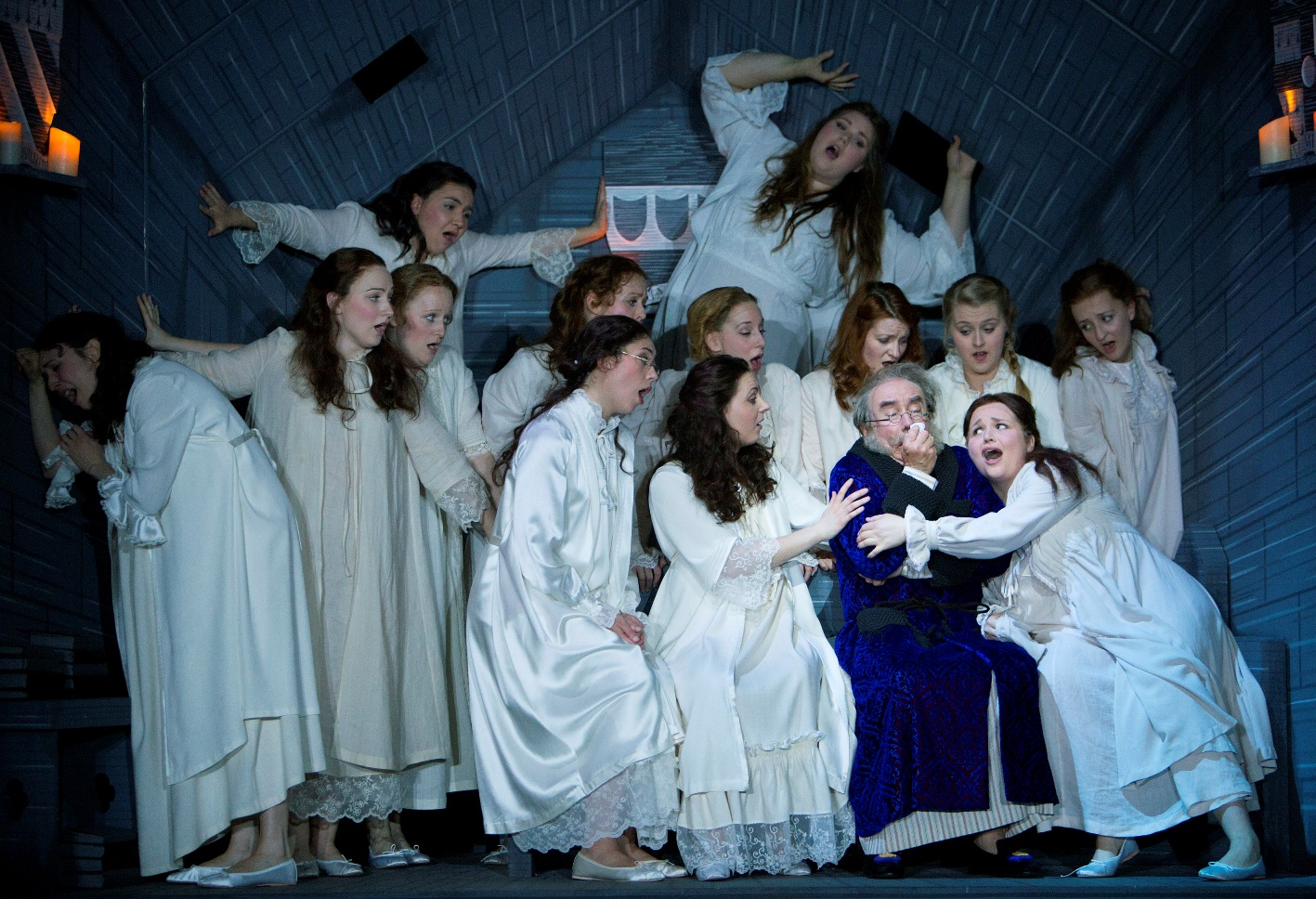 Major-General Stanley (Richard Suart) surrounded by his daughters in Scottish Opera's The Pirates of Penzance