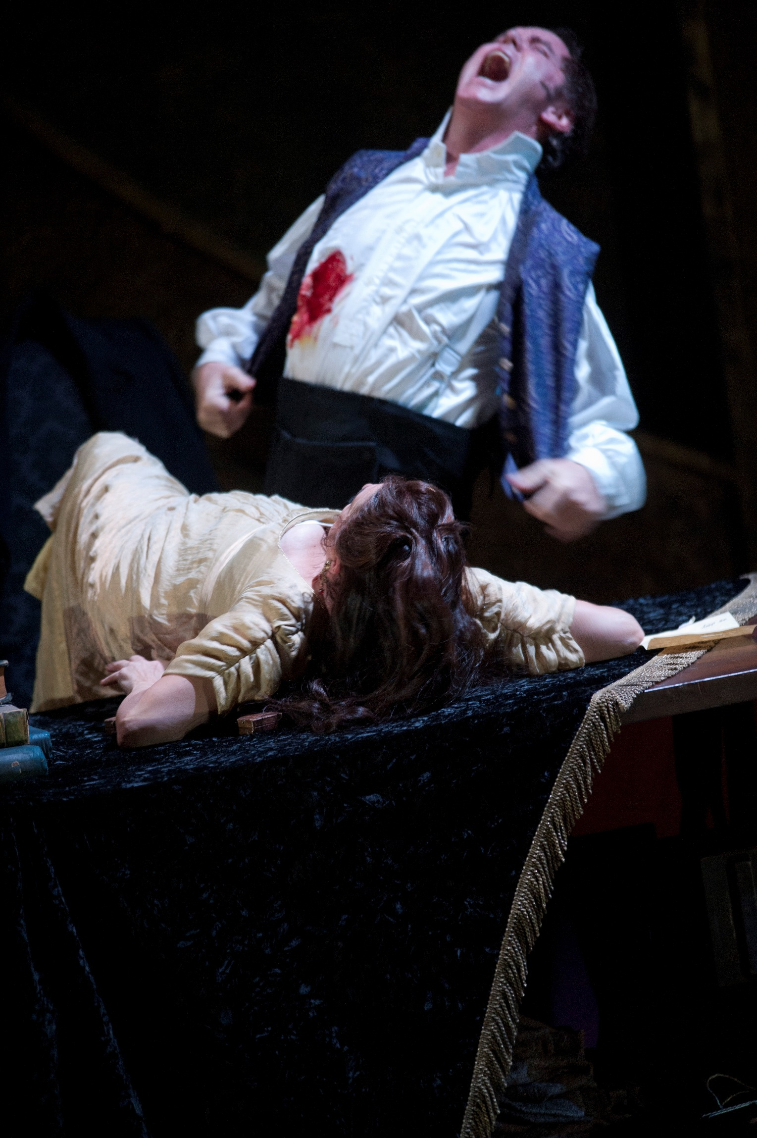 Anthony Michaels-Moore's Scarpia reels from the fatal 'kiss' of Tosca (Claire Rutter) at ENO