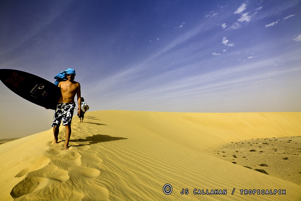 SamBleakley5.jpg_surfer_dude_in_dunes