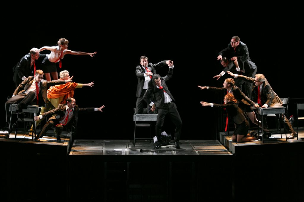 Ensemble in Theatre de la Vile's Rhinoceros at the Barbican